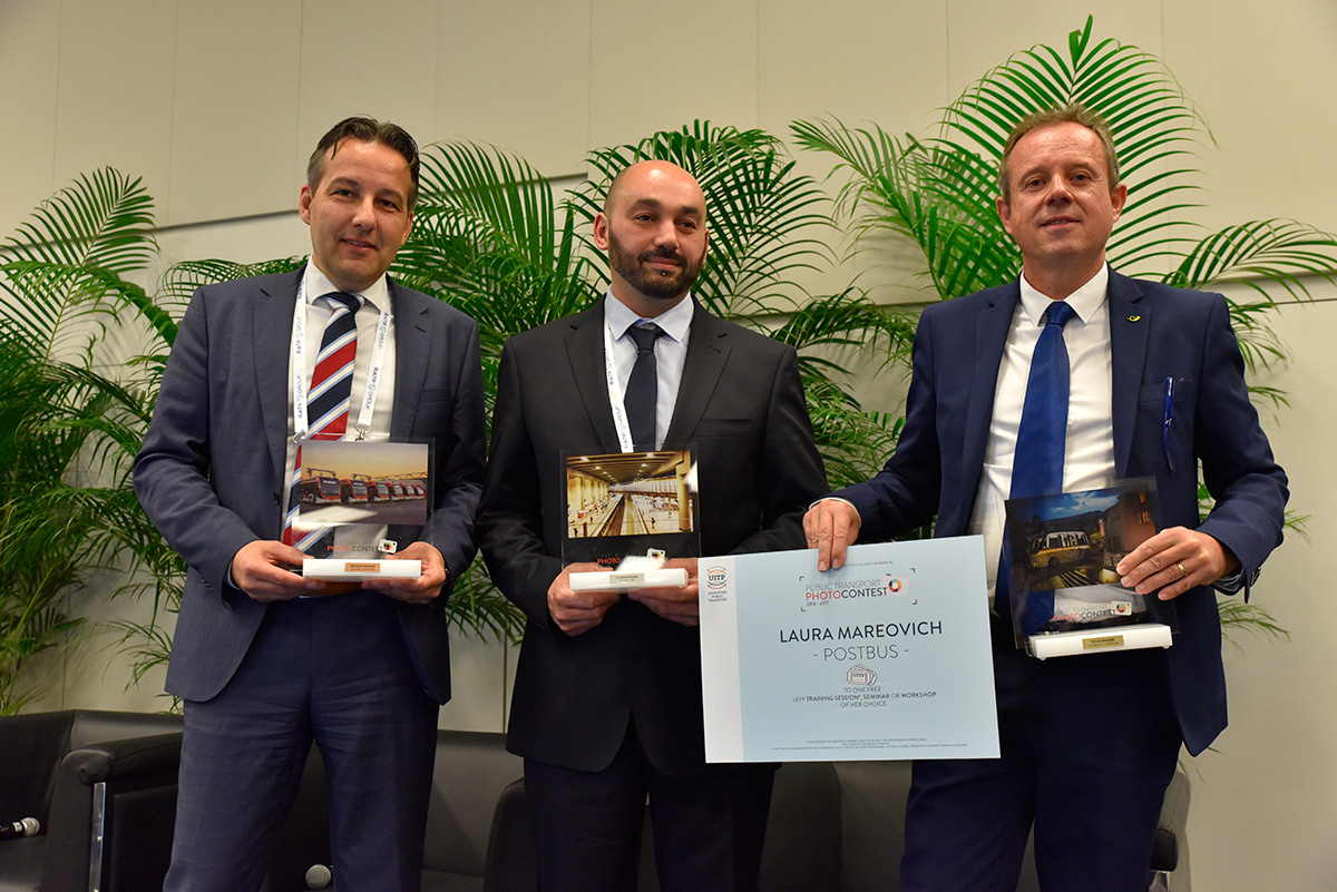 The three winners of the UITP Photo Contest. From left to right: Alex de Jong from VDL Bus Coach (Bronze winner); Taïb Chabbi from STIB (Silver winner); André Burri, representing Laura Mareovich, from PostBus (Gold winner). - © UITP / P. Bourque